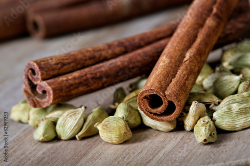 Still-life from cardamom and cinnamon close up