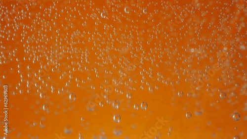 Macro bubbles of water on orange background
