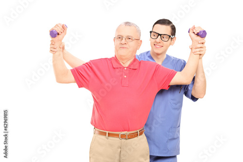 Physiotherapist showing an exercise to mature man