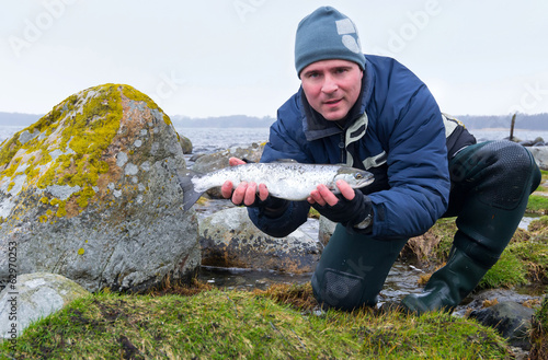 Men with sea trout fishing trophy