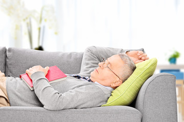 Senior man sleeping on sofa