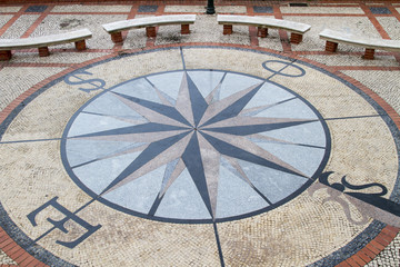 View of a stone pavement mosaic of a wind rose pattern.