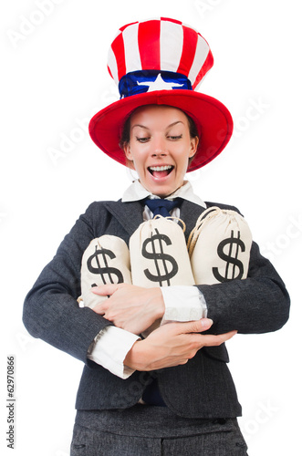 Businesswoman with sacks of money on white