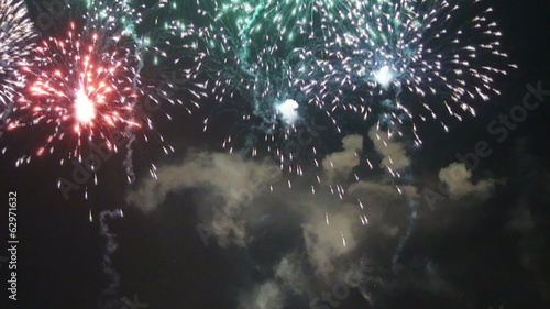 Multicolored fireworks (salute) with the black sky background