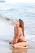 Young woman in a bikini on the sea