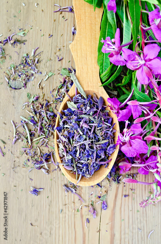 Herbal tea of fireweed on wooden spoon