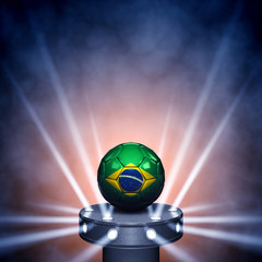 Soccer ball with brazilian flag on display copyspace