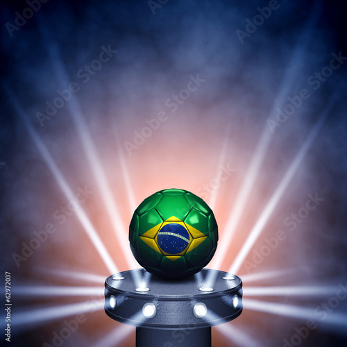 canvas print picture Soccer ball with brazilian flag on display copyspace