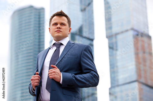 Businessman near office towers