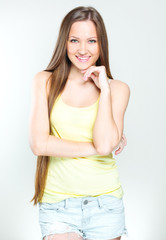 portrait of a beautiful young brunette girl dressed trendy. fash