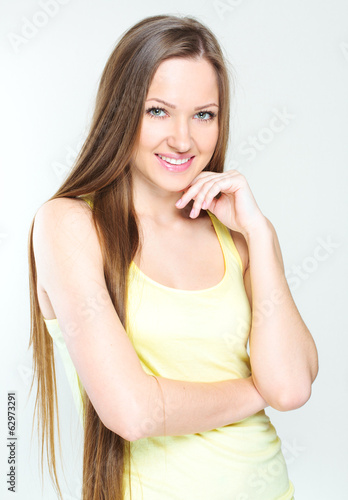 Beautiful young woman with long hair