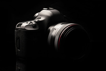 Professional modern DSLR camera low key image