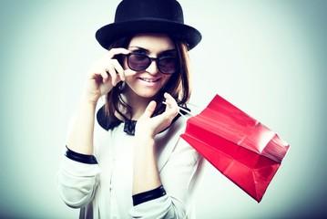 Retro fashion portrait of woman with shopping bag