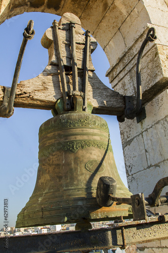 Close view of a old bell tower in Faro, Portugal.