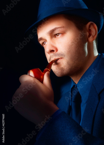Man with Hat Smoking a Pipe Close Up