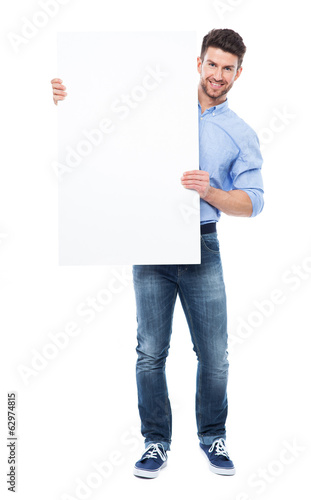 Young man holding blank placard