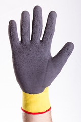 hand with glove making sign of stopping