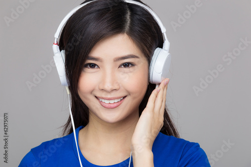 Asia woman listen to music