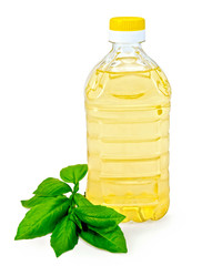 Vegetable oil in a bottle with basil