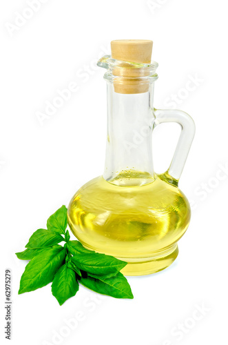 Vegetable oil in a carafe with basil