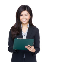 Asian businesswoman record with clipboard