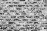 Old grunge brick wall background. Black and white