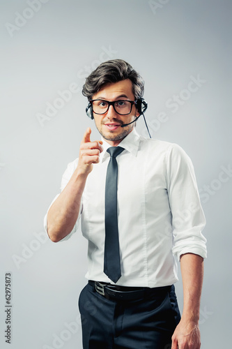 Businessman with headphones gestures