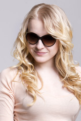 Blond girl with sunglasses