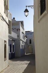 Narrow alley in Assila in the twilight