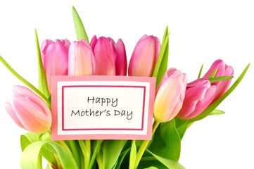Happy Mother's Day card among a bouquet of pink tulips