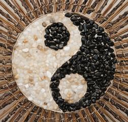yin yang symbol made of pebble stones