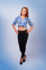 Fashionable young woman in casual wear isolated on blue