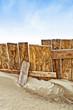 Vintage wooden fence on sandy beach
