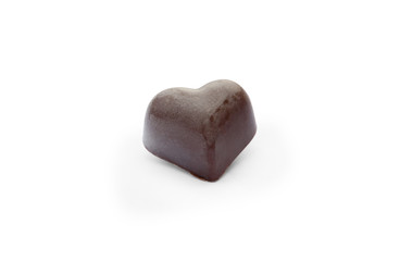 black chocolate candy in the  shape of heart