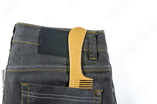 Gray jeans and comb isolated on white background