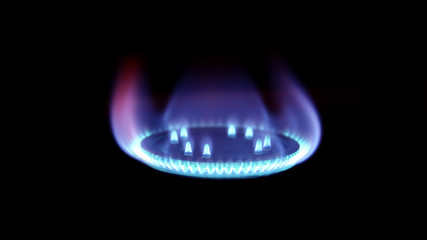 Burning natural gas on burner