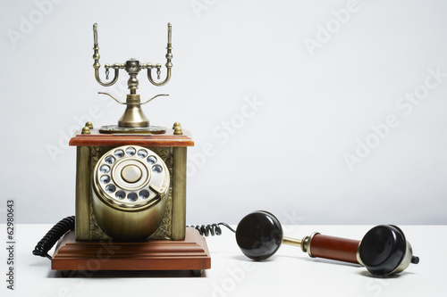 Antique telephone on white background