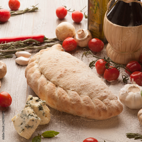 Calzone with ham mushrooms pizza