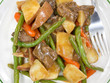 Close view of beef and vegetables with fork