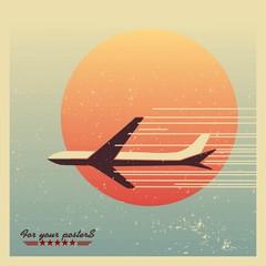 airliner flying against the evening sun emblem