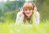 Fototapety Beautiful young woman with headphones