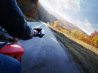Race motorcycle with traveling in forest road.