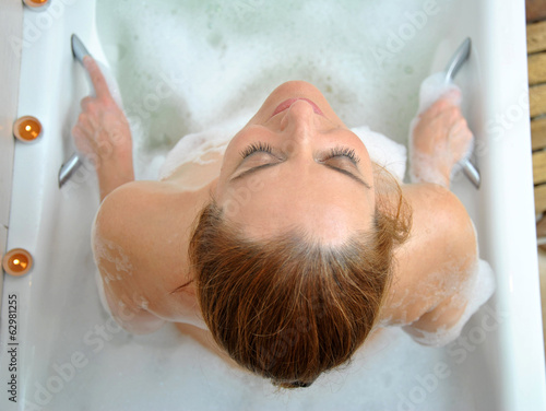 Woman bathing with a lot of foam