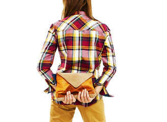 Back view of woman in plaid shirt holding a handbags