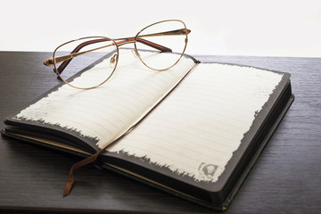 glasses and notebook on a table