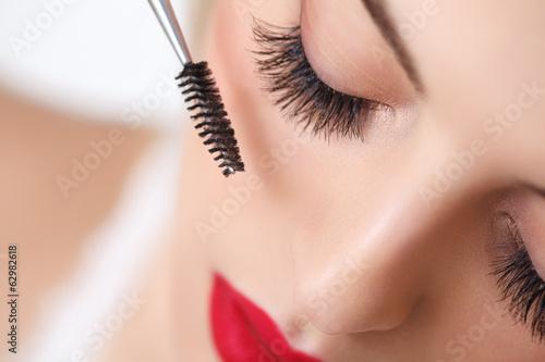 Tela Woman eye with beautiful makeup and long eyelashes. Mascara