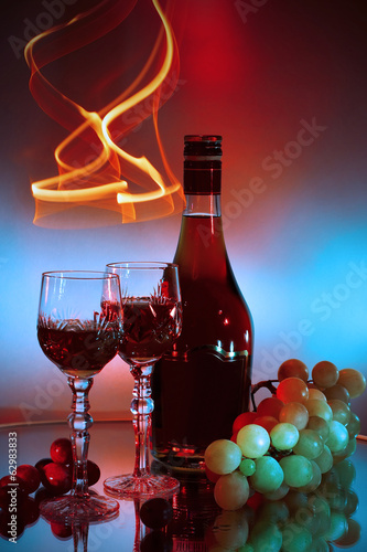 Bottle, glass of cognac (brandy) and bunch of grapes