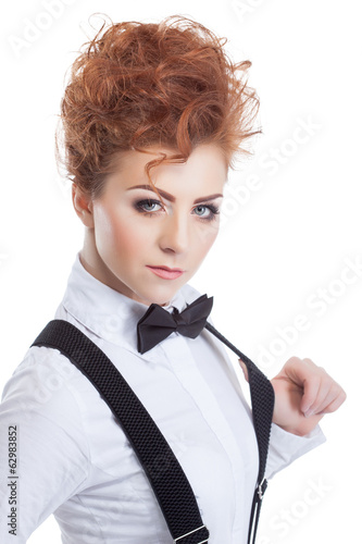 Cute red-haired model in blouse and bow-tie