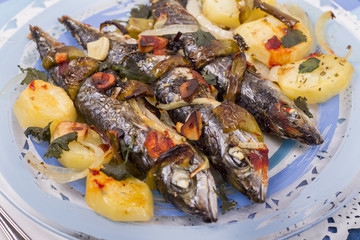 Close up view of cooked mackerel fish with potato.