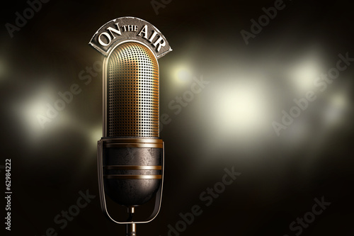 Vintage microphone illuminated by flash